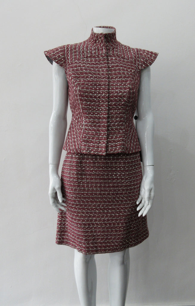 Sleeveless Jacket, Mid-Crop red & grey weave with extended cap at shoulder point for faux sleeve top. Matches with 110701 Yoke Skirt. CB Length 49cm. 450g approximate weight. Size 8. 45% Cotton, 35% Nylon, 15% Polyester, 5% Viscose Lining: 100% Rayon Dry Clean Only. Made in Canada
