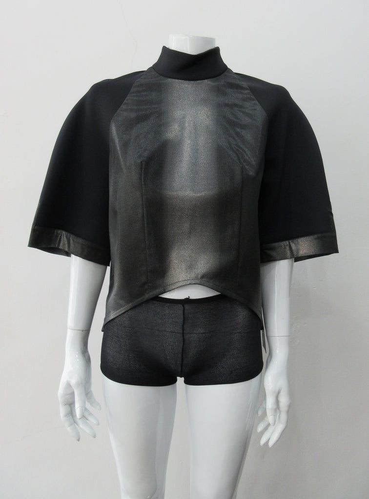 Black Crop Top. Cropped raglan sleeve top in medium weight scuba with contast charcoal colour, shiny fabric front.  Medium sleeves with charcoal shiny contrast trim on sleeve hems.  5cm high collar. CB invisible zipper. CB neck point length 57cm 350g approximate weight.  85% Polyamide, 15% Elastine. Contrast: 98% Nylon, 2% Lycra. Dry Clean Only. Made in England