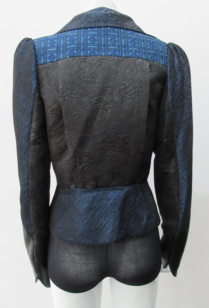 Romanov Crop Jacket. Cropped big lapelled jacket in electric deep blue combination of fabrics & textures. Featuring CF clip at waist. Leather cuffed sleeve hems. CB length 52cm. 200g approximate weight. 59% Cotton, 41% Nylon. Contrast: 41% Viscose, 37% Acrylic, 22% Nylon. Lining: 100% Rayon. Dry Clean Only. Made in England