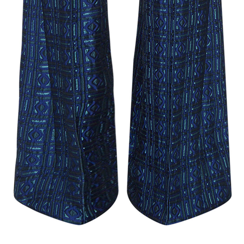 Previously worn sample. High waisted Textured Trouser features blue diamond and square geometric design. 450g approximate weight. 56% Polyester, 36% Acetate, 8% Polyamide. Lining: 100% Rayon. Dry Clean Only. Made in England