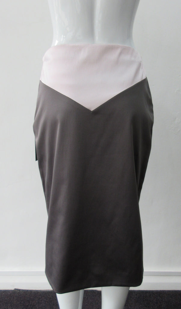 Shiny A Skirt. Chocolate Taupe coloured A-Line skirt with light, soft pink pointed panel on upper part. Stretch woven for greater ease and fit. Invisible side zip. Can be paired with 170609B Dark Spy Top. CB length 67cm. 200g approximate weight. 97% Polyester, 3% Elastine. Lining: 100% Viscose. Made in England