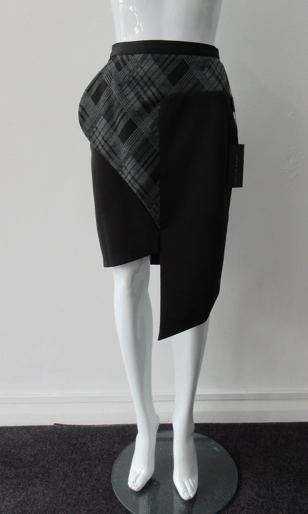 Assymetrical Plaid Front Skirt with plaid contrast panel extension can be flipped to right or left. Solid black bodice with grey tatran plaid panel. CB length from waist 96cm. 500g approximate weight. 97% Cotton, 3% Lycra. Contrast: 63% Polyster, 33% Rayon, 4% Sapndex. Lining: 100% Viscose. Made in Canada