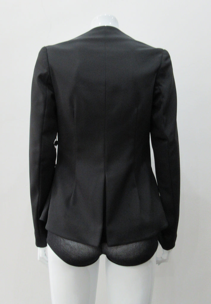 Dark Corset Jacket. Geometric cut lower front metal zip jacket with flared peplum-style hem in medium length. Designed for a tighter fit around the bust area. In solid black with slight stretch. CB length 63cm. Sleeve length from side neck point 78cm. 750g approximate weight. 95% Polyester, 5% Spandex Lining: 100% Viscose. Dry Clean Only. Made in England