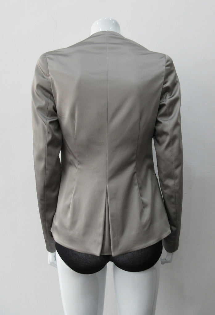 Corset Jacket. Geometric cut lower front metal zip jacket with flared peplum-style hem in medium length. Designed for a tighter fit around the bust area. In solid silver taupe colour with slight stretch. CB length 63cm. Sleeve length from side neck point 78cm. 750g approximate weight. 95% Polyester, 5% Spandex. Lining: 100% Viscose. Dry Clean Only. Made in England