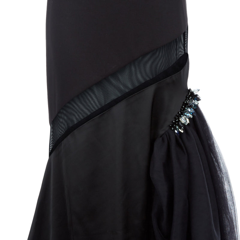 Black sequin and multipanel satin dress with black left thigh gathered tulle with clear bead accent, single strap and conceal zip closure. 62% Viscose, 3% Elastine, 35% Polyethylene. Contrast: 95% Polyester, 5% Spandex. Lining: 100% Viscose. Dry Clean only. Made in England