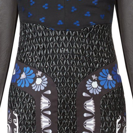 Full length multi-textured print dress featuring faux leather criss-cross paneling and black sheer sleeves. Semi-open top shoulders. Upper bodice has black with blue spotted design.
