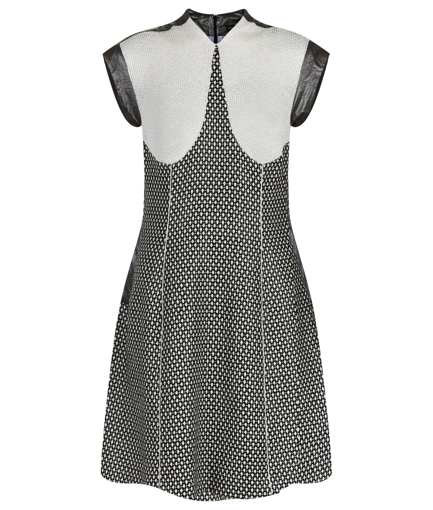 Swing Dress. Mixed array of black & white cross tooth with sheer chunky knit upper bodice, and grey Tyvek shoulder & arm panel. Contrast piping on front & back seams. CB length from neckpoint 96cm. 110g approximate weight. 86% Cotton, 14% Nylon. Contrast: 100% Acrylic. Lining: 100% Rayon. Dry Clean Only.Made in England