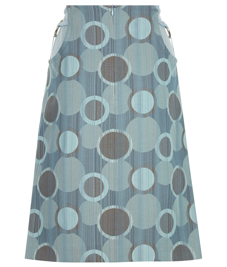 Round Waist Skirt. Medium length skirt in multi coloured sea green weave design. Turbine 3 blade concept design on side hips with stretch trim, over sheer sea green mesh. CB skirt length 59.5cm. 80g approximate weight.