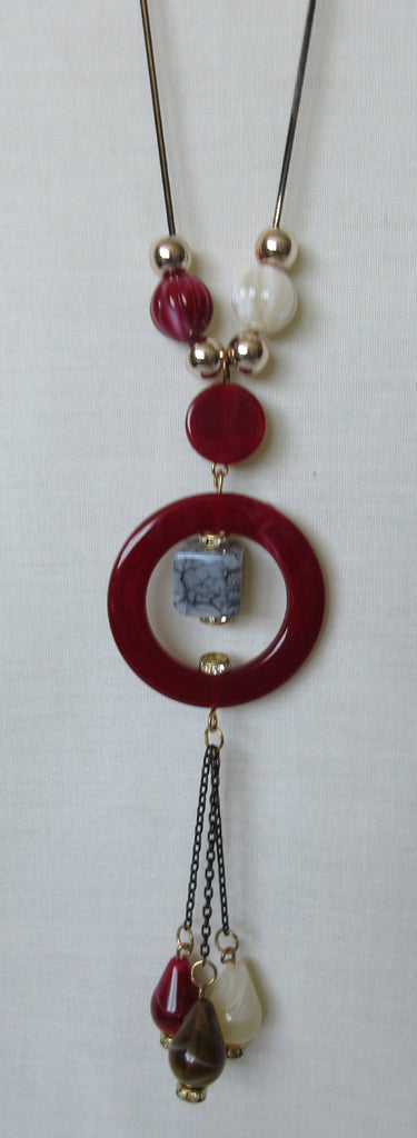 Red Ring Necklace red circle, blue stone multiple beads beige red gold close-up image photo picture