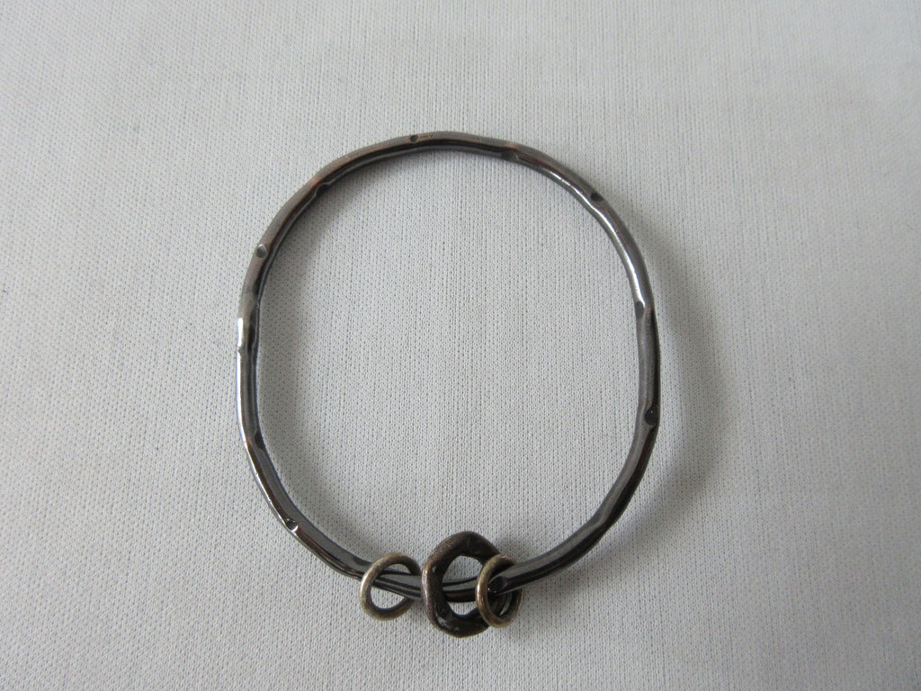 Karyn Chopik Dented Dark Silver Bracelet with 3 Small Rings, Sterling Silver, Antiquated Brass & Copper, Size: 1 Medium -6.5cm inside diameter. 35 grams approximate weight, Made in Canada