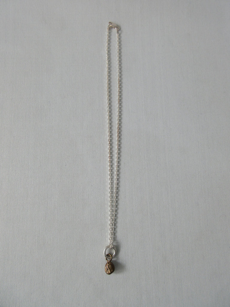 20A63 Brass Person Figure Steel Necklace, Brass person attached to stainless steel chain. Full length when worn 25cm. 12 grams approximate weight.