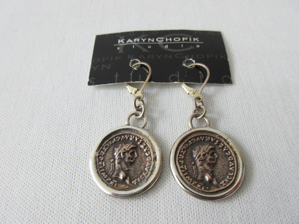 Karyn Chopik Roman Coin Earrings. Item Number E1155. Antiquated Bronze and Antiquated Brass. 25g approximate weight. Made in Canada