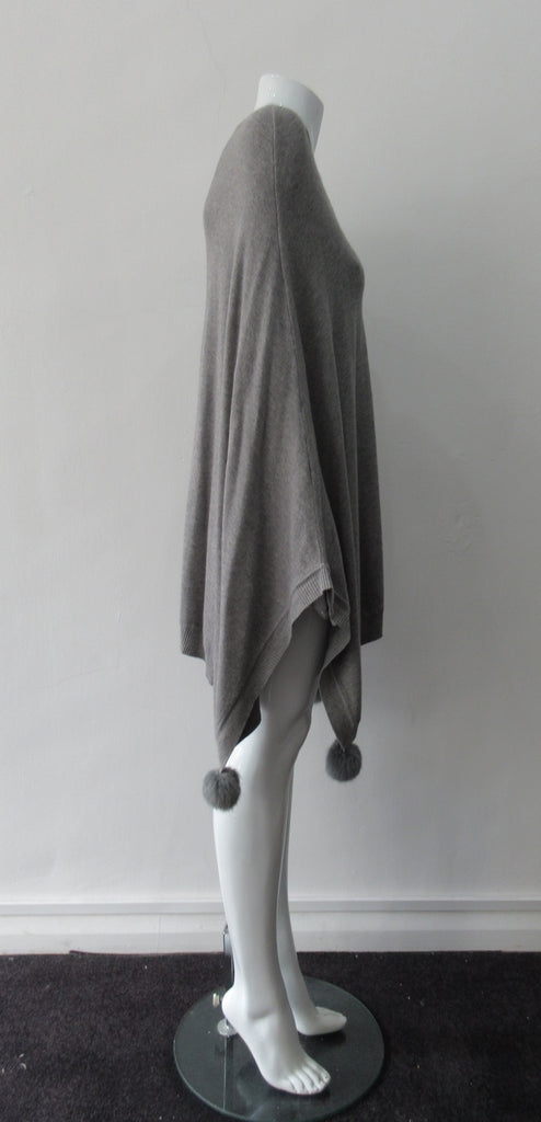 Generous cut swing poncho for greater ease and comfort. 4 fuzz balls located at corner points.  Art. 4461, 52% Viscose, 35% Modal, 8% Elastic, 5% Cashmere, Dry Clean Only, Made in Italy, CB Length 81cm approximate length.