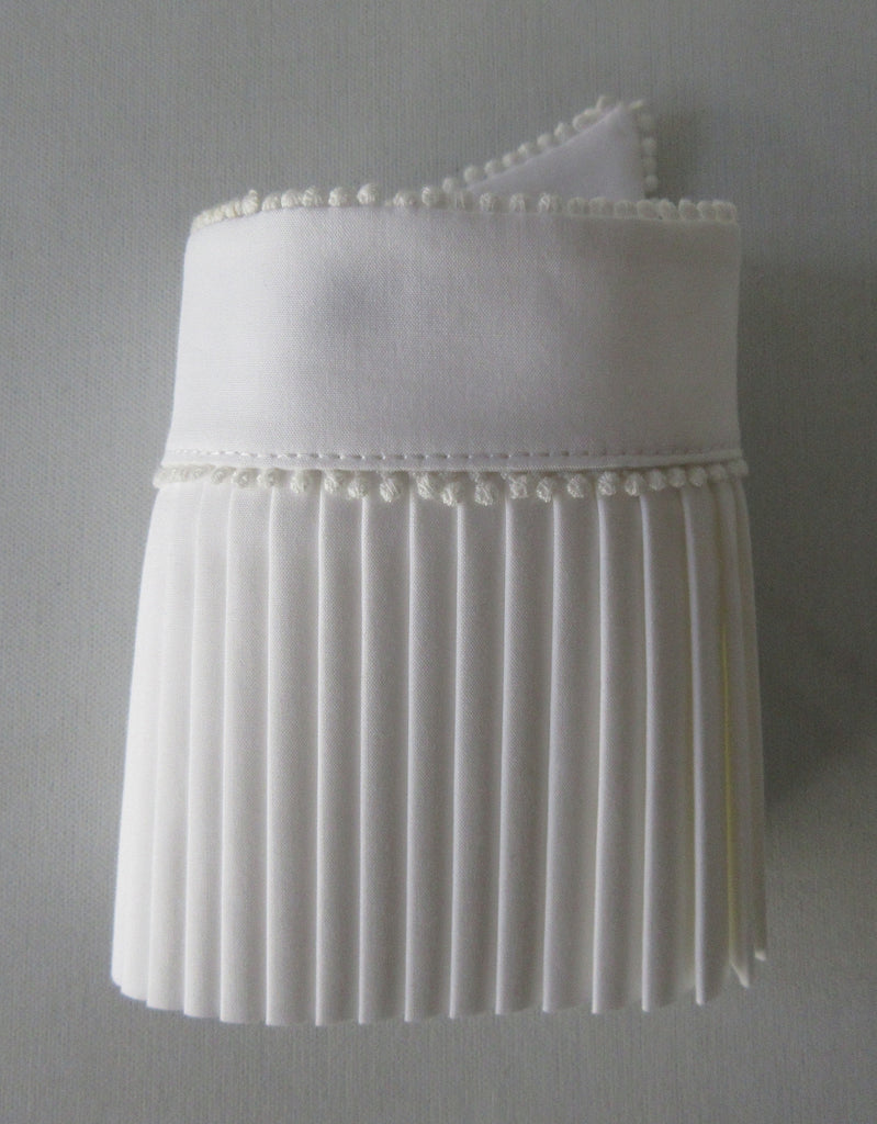 Catherine Osti White Pleated Cuffs 100% Cotton. Textured white, similar to dress shirt trim. Micro cotton ball trim on side and bottom. Snap Closure. Size M -18cm width from snap to snap Size L -20cm width from snap to snap, 60g approximate weight, comes in white box. Made in France