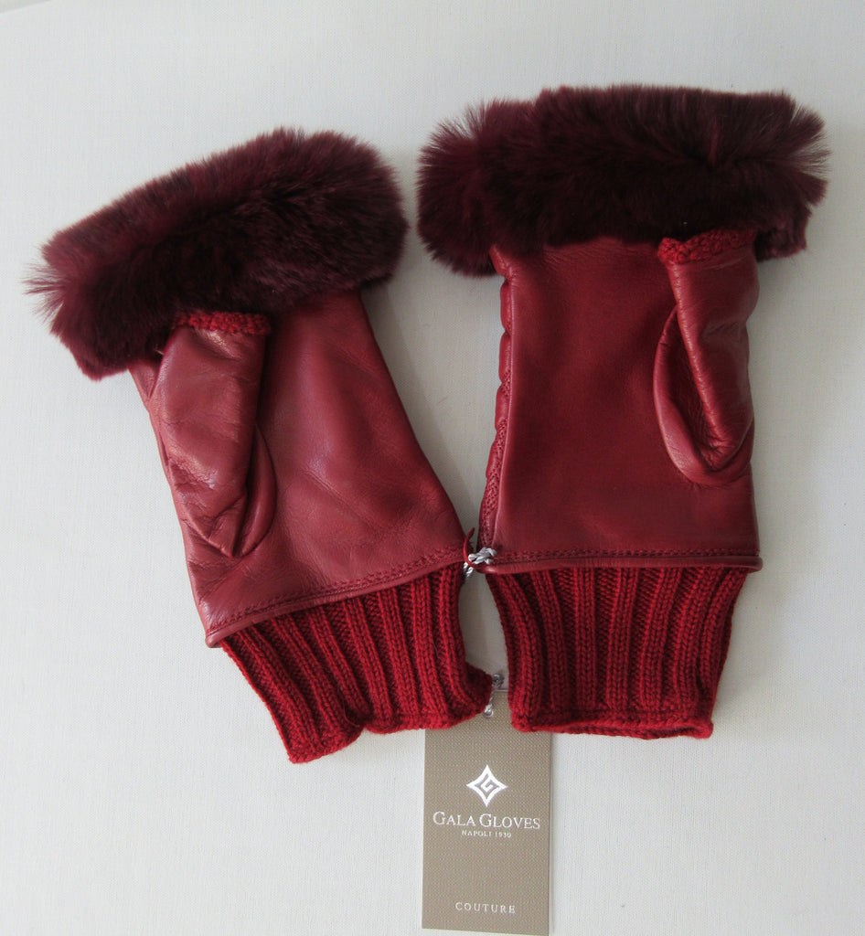 Gala Gloves Couture Red Fingerless Gloves, Item Number D596NALAD261RUB 948.010. Ruby Red coloured textured leather with knit base, leather fingerless glove with fur trim for fingers. Fur unknown. 80g approximate weight. Made in Italy