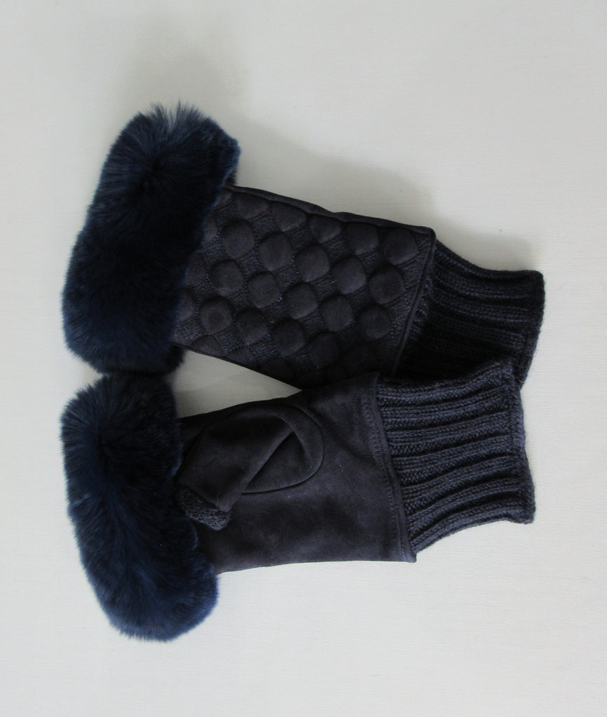 Gala Gloves Couture Navy Fingerless Gloves. Item Number D596SULA048 Blu. Navy Suede fingerless gloves with raised circular dot design, with fur trim for fingers. Navy knit base, suede gloves and fur trim. Made in Italy