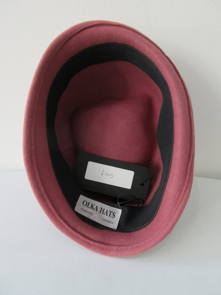 Olka Dusty Rose Hat with lace & mesh trim design. Size unknown. Inside circumfrence 59cm. Length 27cm. Width 20cm. Height 11.5cm back, 10.5cm front. 26g approximate wight. 100% Wool. Made in Canada