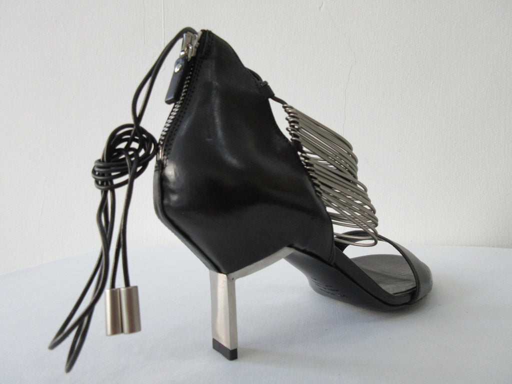 Vic Matie Black Curved Metal Heels, Product Number: Vic Matie 1N7002D.NB2CDZB323 Sandalo Modig/Acess 101/109, 4cm metal heel. 100% Leather with Stainless Steel rings and inside laces. Made in Italy