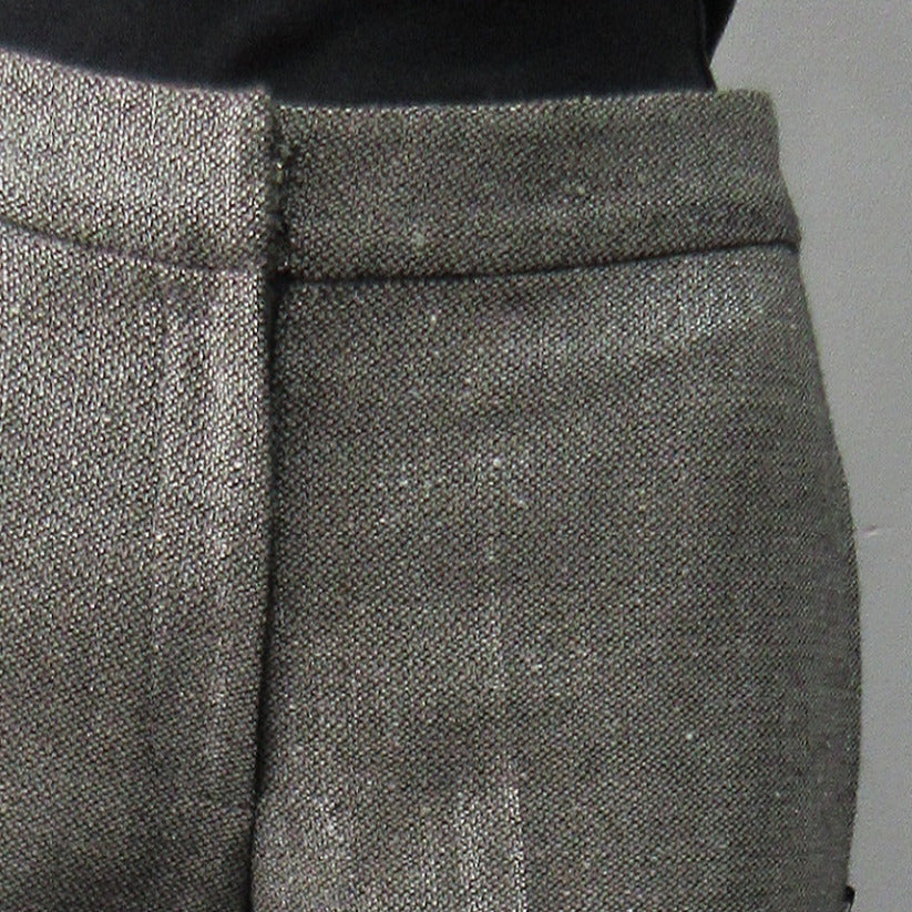 Soft micro-tweed with slight shine. 53% Wool, 31% Viscose, 14% Silk, 2% Polyeurathane. Size 8, Inseam 82.5cm, Outseam 102cm, Dry Clean Only,  Made in England.
