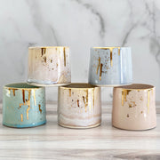 Noted Candles and Michelle Barrett Collaboration Vessels.Vessels have glazed ceramic finishes of assorted colors, all with real gold drips.
