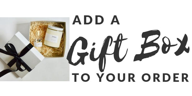 """Add a Gift Box to your order"" Gift box with classic black bow, containing an Original Candle, and a match bottle."