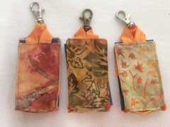 Hand sanitizer holder with clip on the go sanitize sold at do good shop ethical gifts