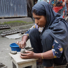Bangledesh artisan working on handmade ethical terra cotta planter sold at DO GOOD SHOP