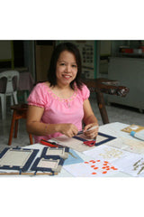 artisan making ethical handmade paper photo frames in the Philippines