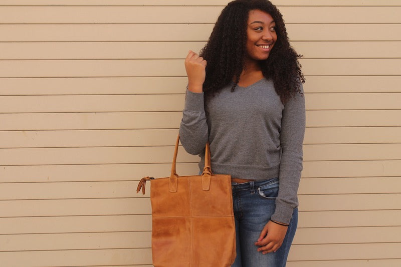 ethical fair trade genuine leather handbag on teenage african american model taken for do good shop nonprofit