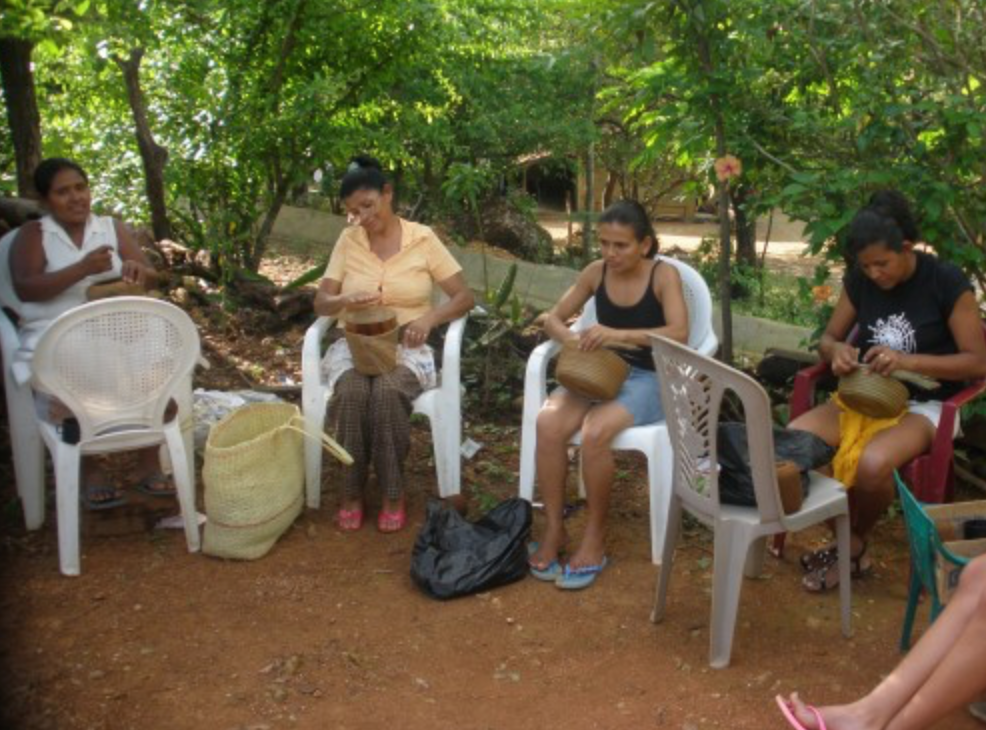 group of artisan women in Honduras making fair trade gifts for do good shop