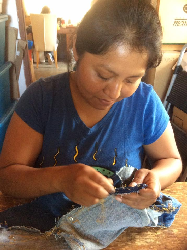 mexican artisan handmaking denim apron for do good shop