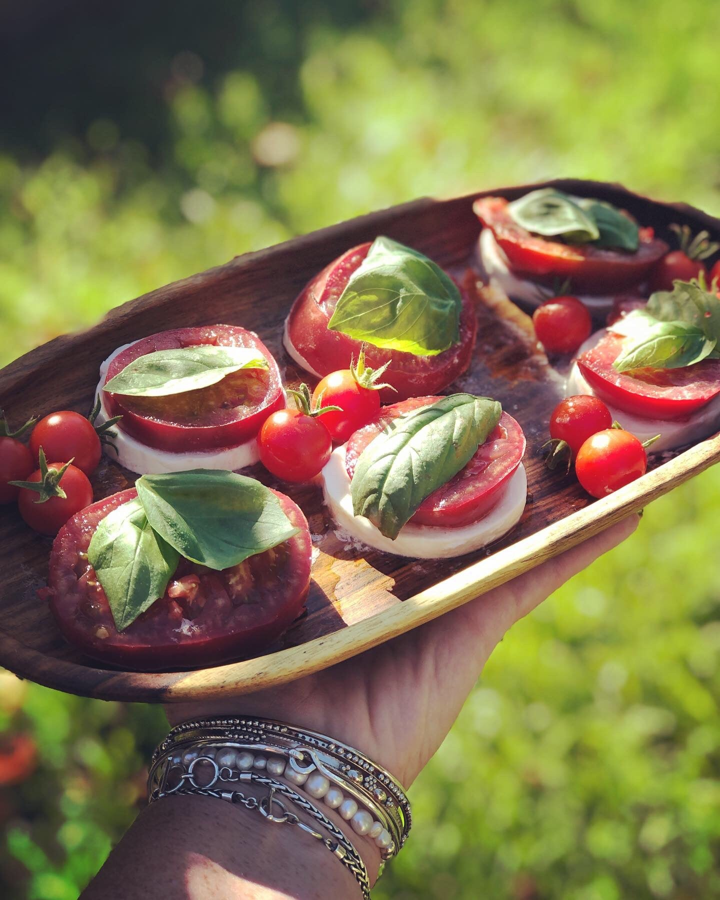 summer caprese salad on fair trade wood tray from do good shop with balsamic vinegar