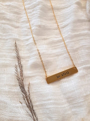 brass.16K.gold.be.still.necklace.hand.stamped.woman.made.sold.at.do.good.shop.ethical.gifts.jewery