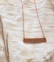 rose.gold.be.still.necklace.hand.stamped.woman.made.sold.at.do.good.shop.ethical.gifts.jewery