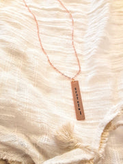 grateful.rose.gold.vertical.bar.necklace.handmade.by.women.survivors.sold.at.do.good.shop.ethical.gifts.jewelry