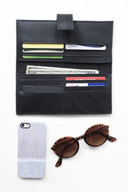 Leather-Wallet-Black-Lining-genuine.ethical.gifts.for.her.do.good.shop.nonprofit.shown.with.credit.cards.sunglasses