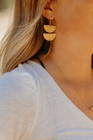 brass.tassel.earrings.navy.handmade.by.women.artisan.quality.sold.at.do.good.shop.ethical.gifts.jewelry.on.ear.model