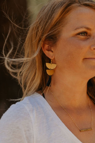 brass.tassel.earrings.navy.handmade.by.women.artisan.quality.sold.at.do.good.shop.ethical.gifts.jewelry.brave.stamped.bar.necklace.brass