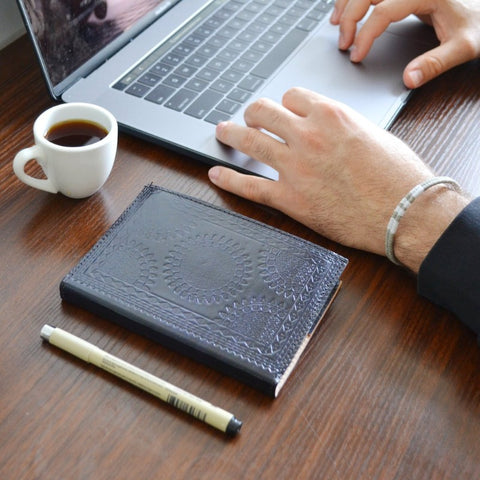 genuine.leather.journals.embossed.fair.trade.ethically.artisan.made.sold.at.do.good.shop.aubergine.laptop.coffee.pen.desk.employee.work.from.home