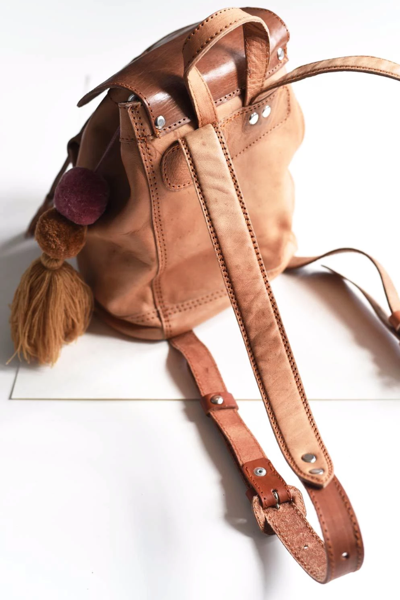 Small Leather Backpack with Pom Tassel - do good shop ethical gifts