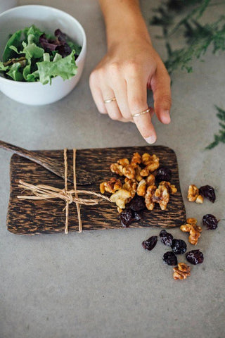 cheese.and.butter.board.handmade.fair.trade.palm.wood.knife.tray.set.of.2.sold.at.do.good.shop.ethical.gifts.for.kitchen.serving.appetizers.with.food.nuts.dried.fruit