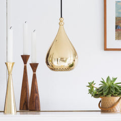 brass pendant and candleholders with teak candleholder scandinavian and nordic designer homewares