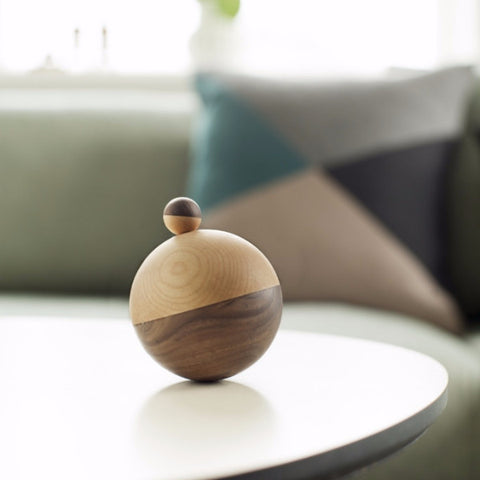 Wooden spinning top toy or design piece from Denmark
