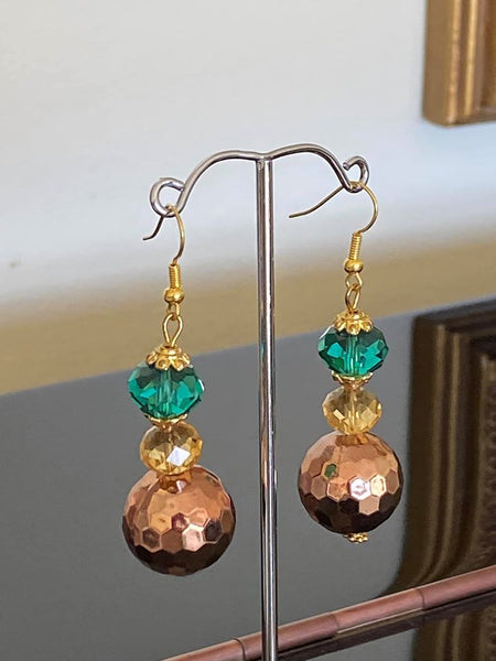 Round copper beads with bottle green glass beads.