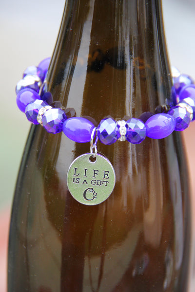 "Navy blue glass beads with ""Life is a gift"" silver charm bottle bracelet"