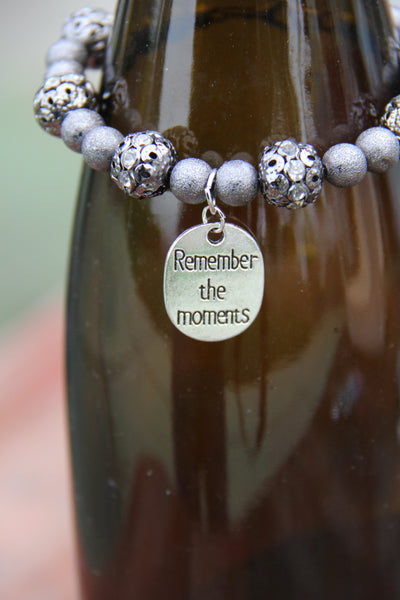 "Grey colored lite weight beads with ""Remember the moments"" silver charm"