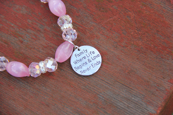 Pink glass beads and a silver charm for bottle bracelet
