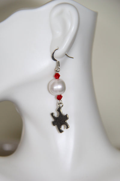 Fresh water pearls with silver puzzle piece charms and red Swarovski crystals