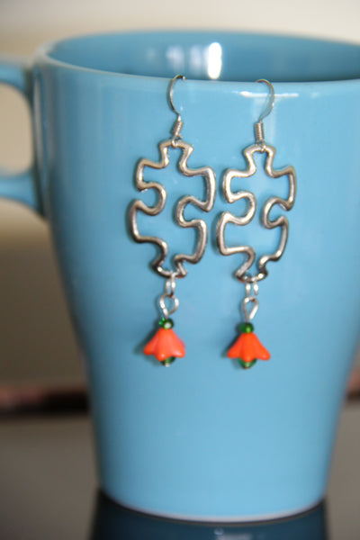 Puzzle piece ear rings Silver orange flower