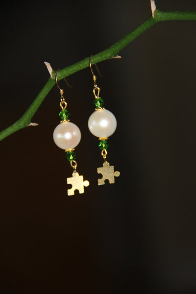 Fresh water pearls with green Swarovski crystals and brass gold plated puzzle charms